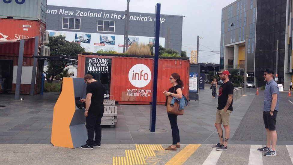 """People using a Moodbank """"cash"""" machine in Auckland, New Zealand."""