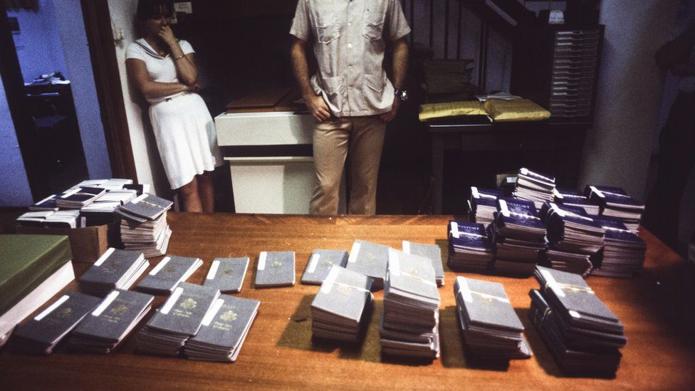 Piles of American passports on tables from the killing