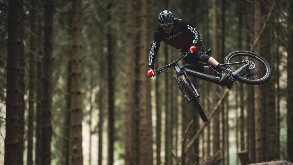 A cyclist doing a stunt on an e-bike