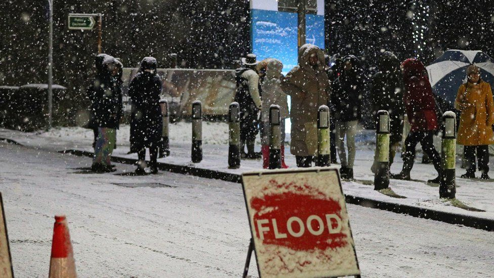 Snow falls in East Didsbury, Manchester, where homes are being evacuated due to risk of flooding