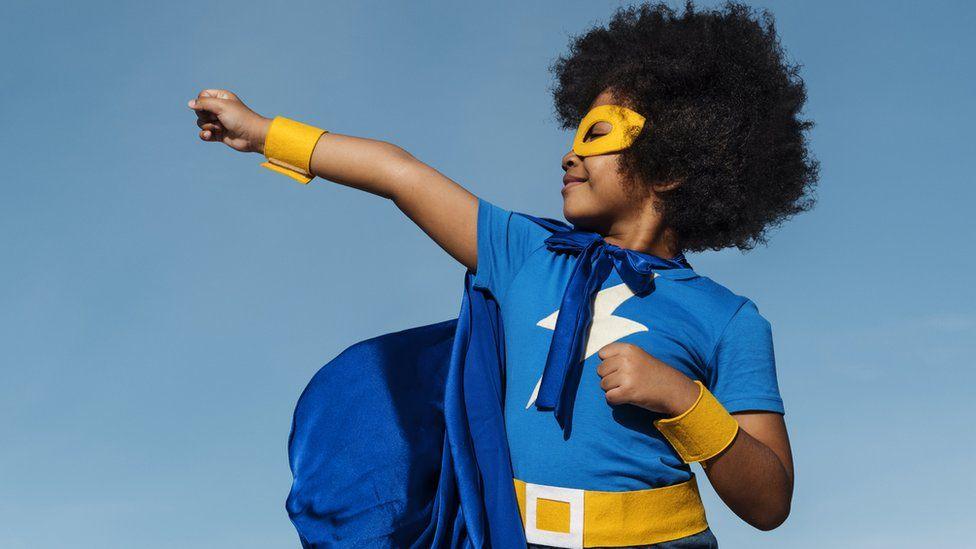 A boy in superhero costume