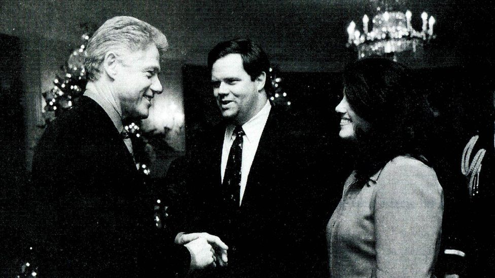White House intern Monica Lewinsky meeting President Bill Clinton at a White House Christmas party in 1996