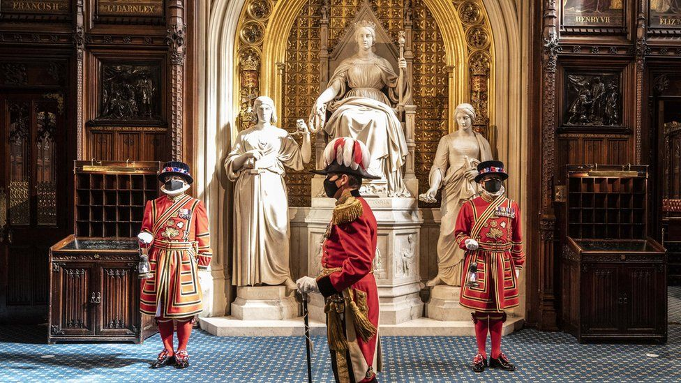 Masked Yeoman warders take up their positions in front of the statue to Queen Victoria outside the House of Lords during the ceremonial search of the Palace of Westminster in London