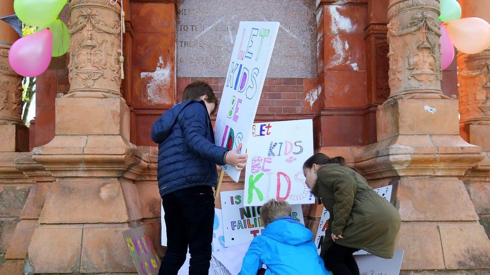 Children with placards at school tests protest