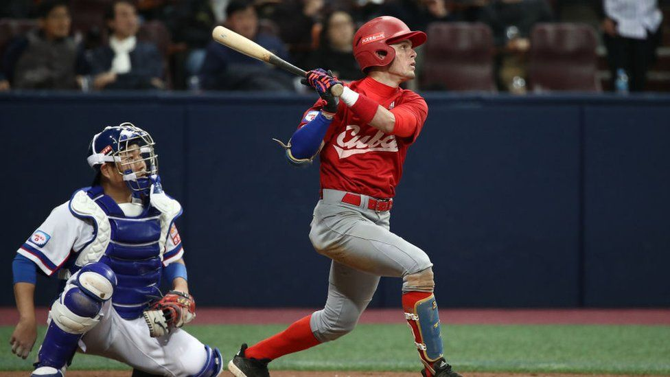 Infielder Cesar Prieto #6 of Cuba flies out in the top of fifth inning during the WBSC