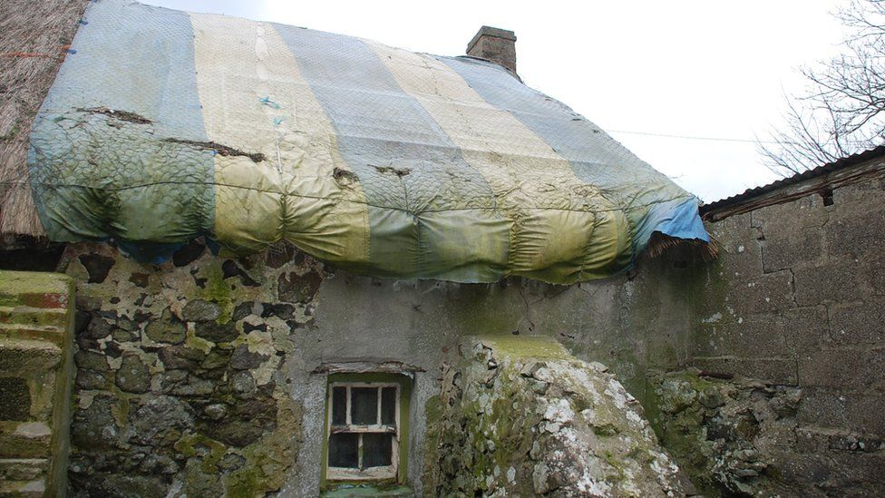 A cattle gate, covered with canvass, has been used as a temporary roof