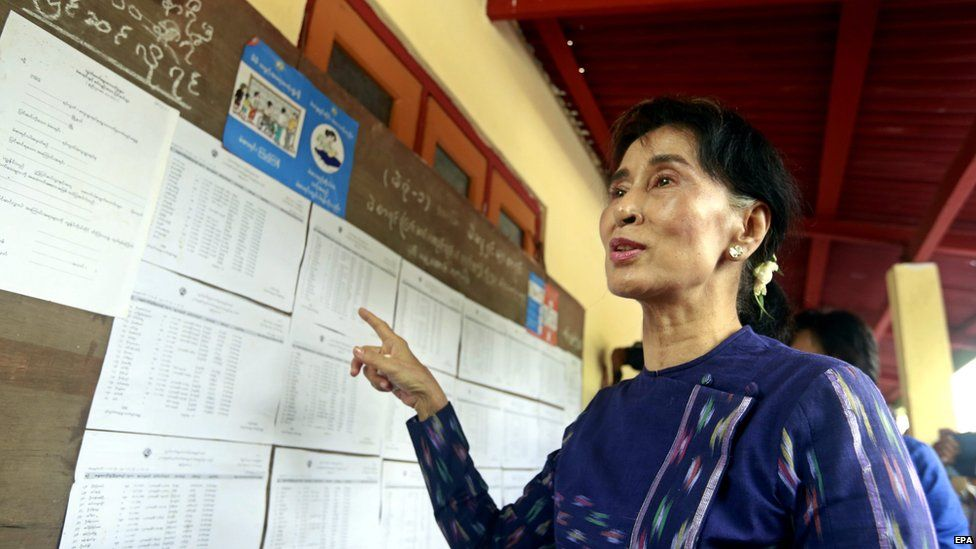 Myanmar opposition leader Aung San Suu Kyi (C) talks to media as she checks the voters list at the Wahtheinkha village in Kawmhu township, Yangon, Myanmar, 04 July 2015