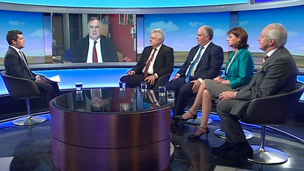Party leaders on Sunday Politics: Mark Williams, on screen, Carwyn Jones, Andrew RT Davies, Leanne Wood, Neil Hamilton, and presenter Arwyn Jones