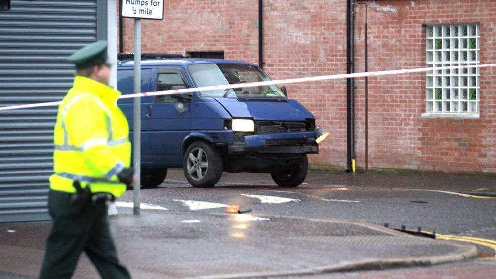 A police officer stands by a cordon at the scene of the bombing