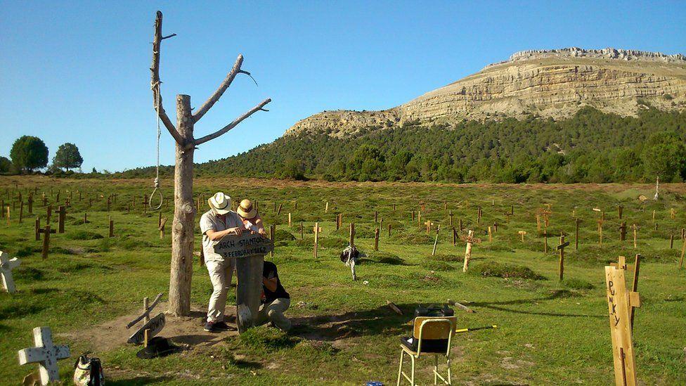 Volunteers maintaining restored site of Sad Hill cemetery scene