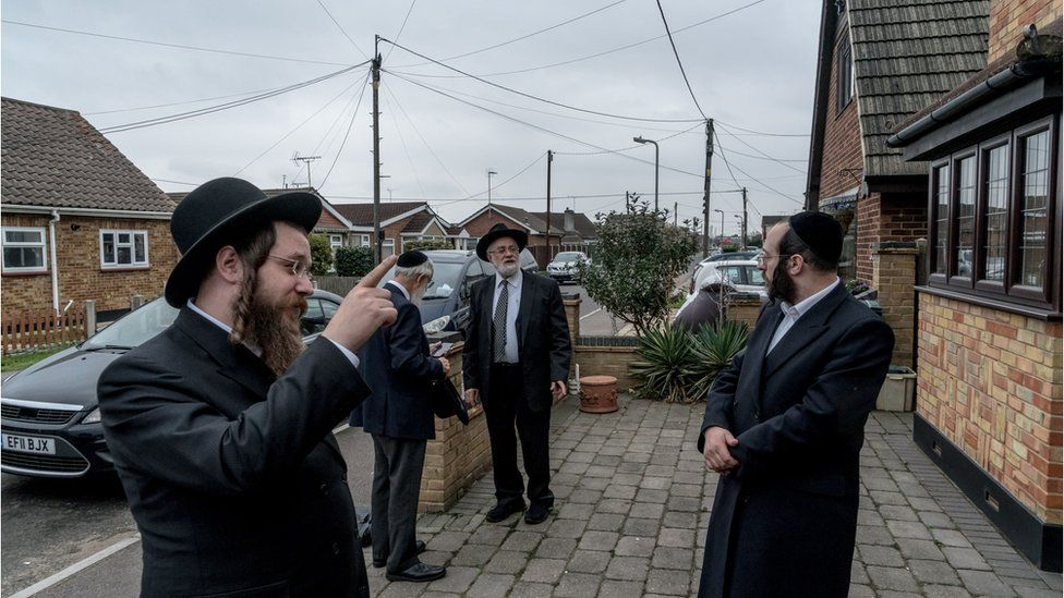 Joel Friedman (right) and colleagues looking at JCoCI's latest house purchase