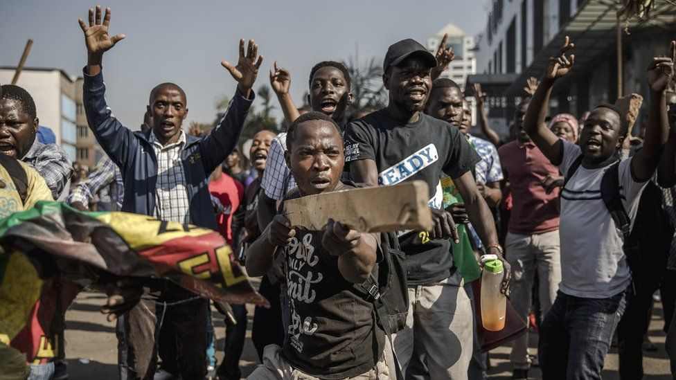 Supporters of Zimbabwean opposition MDC Alliance take part in a protest in Harare over alleged fraud in the country's election, 1 August 2018