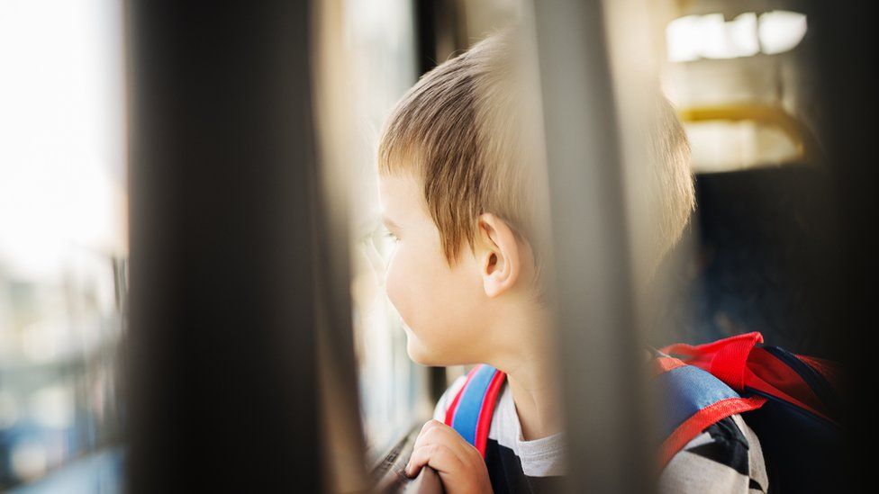 Stock image of a child on a bus