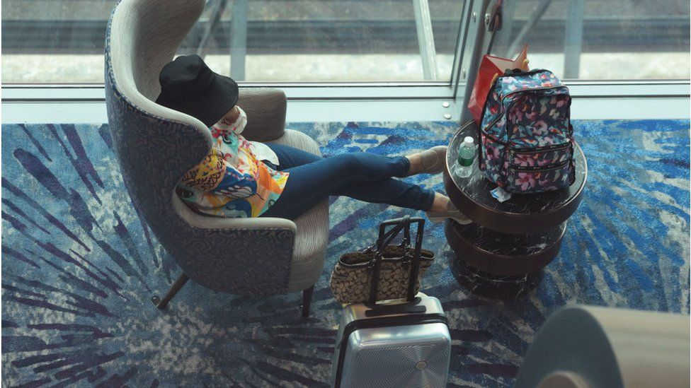 A traveller rests at the transit hall of Changi International Airport