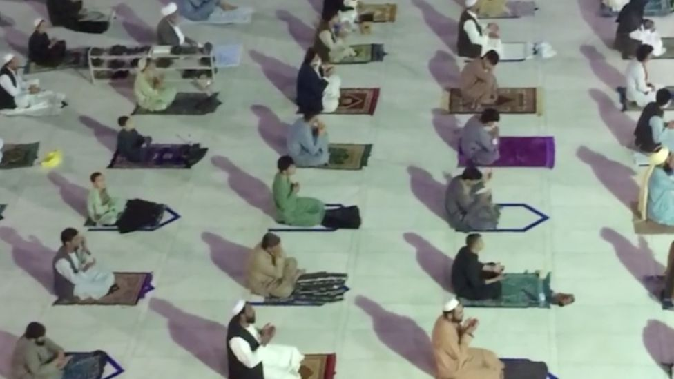 People social distancing while praying in a mosque