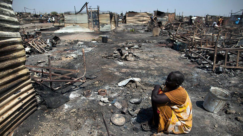 Akki Adduok, a displaced woman residing in the Protection of Civilians (PoC) site in Malakal, South Sudan, sits in the spot where her shelter used to be on February 26, 2016