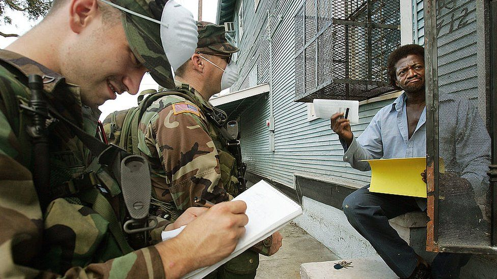 National Guard members talking to a resident in New Orleans