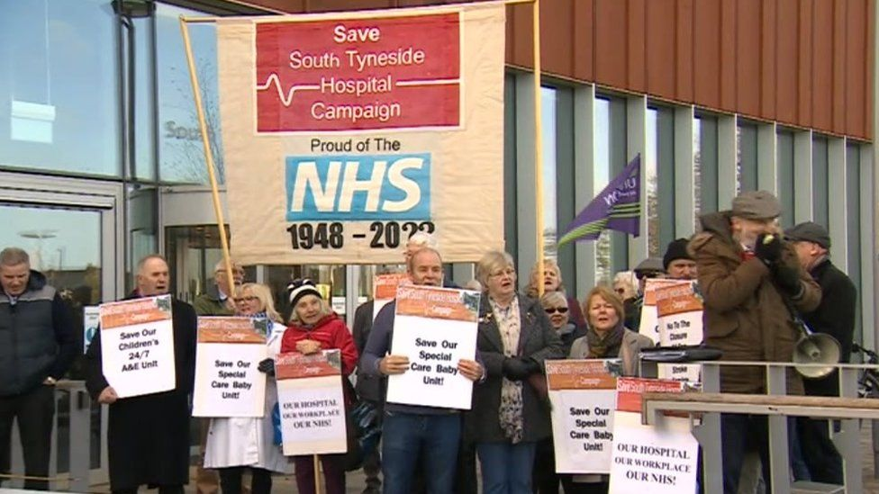 Campaigners carrying banners outside the meeting calling for services to be maintained