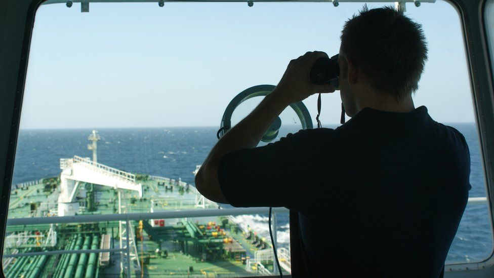 A protection team scan the southern Gulf of Aden for pirates while passing through the High Risk Area