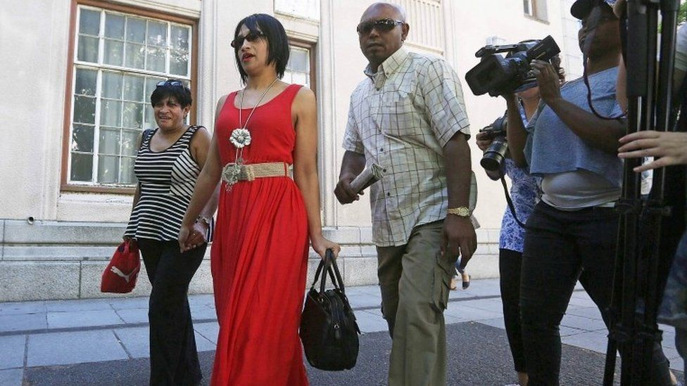 This file photo taken on February 27, 2015 shows Celeste Nurse leaving the Cape Town magistrates court with family members, after attending a hearing during which a 50-year old woman appeared for allegedly kidnapping her daughter