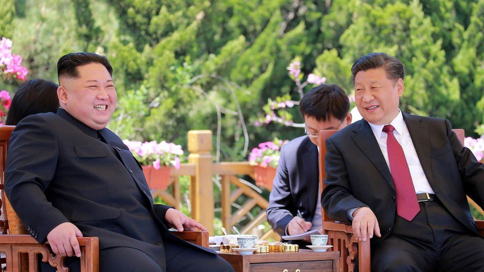 """This file picture from North Korea""""s official Korean Central News Agency (KCNA) taken on May 8, 2018 and released on May 9 shows China""""s President Xi Jinping (R) and North Korean leader Kim Jong Un during a meeting in the Chinese city of Dalian."""