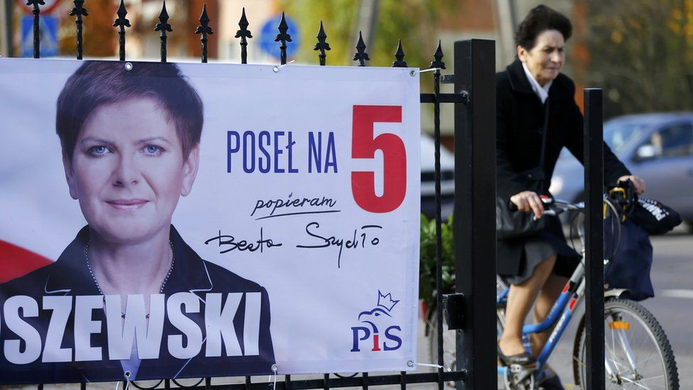 """An election poster depicting Law and Justice""""s (PiS) candidate for Prime Minister Beata Szydlo is seen in Leczyca, Poland"""