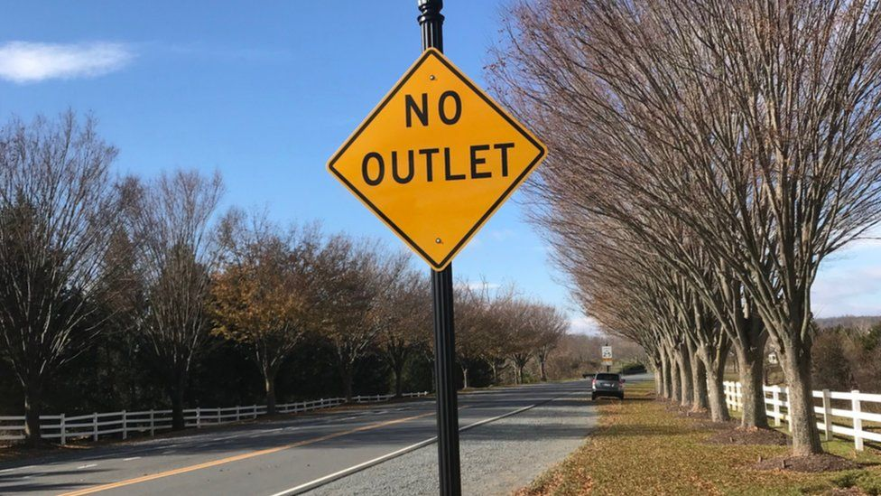 "A road sign that says: ""No Outlet"""