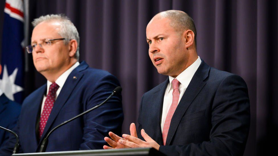 Treasurer Josh Frydenberg speaks alongside Prime Minister Scott Morrison