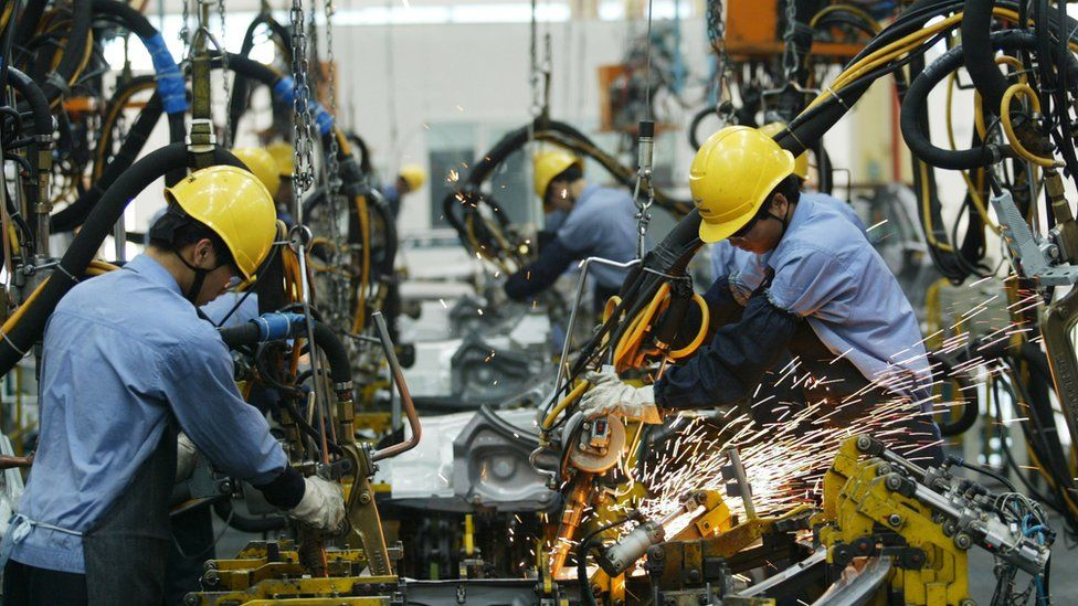 Men work in a factory in China