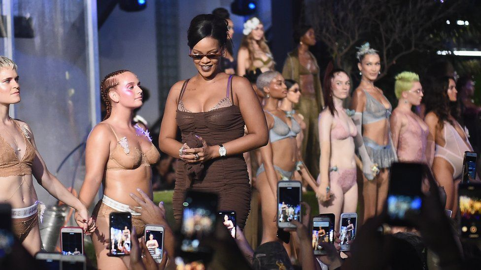 Rihanna walking the runway during the finale of the Savage X Fenty fashion show
