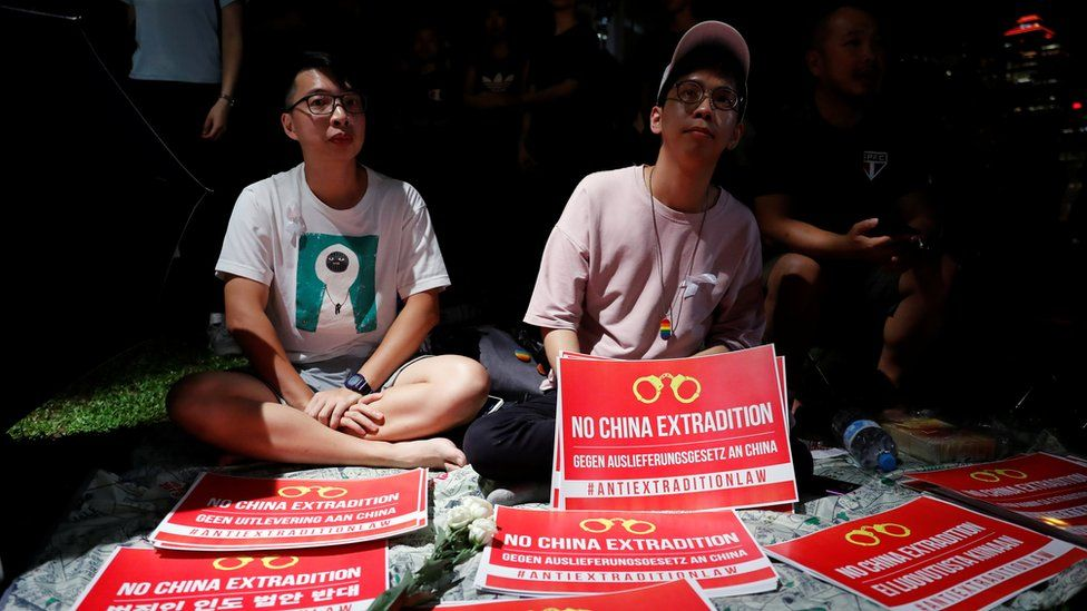Demonstrators protest to demand authorities scrap a proposed extradition bill with China, in Hong Kong