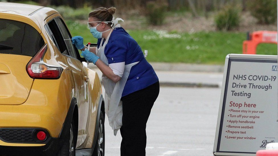 A person is tested at a drive-through coronavirus testing site at Chessington World of Adventures, in Greater London