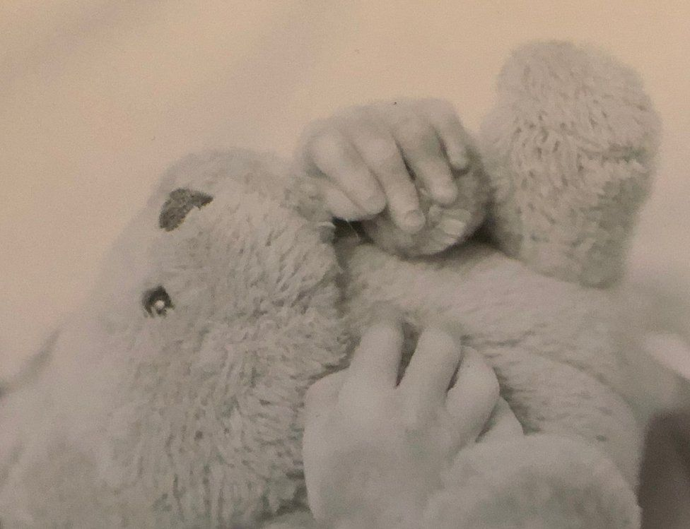 Laura Gallazzi's baby and teddy bear