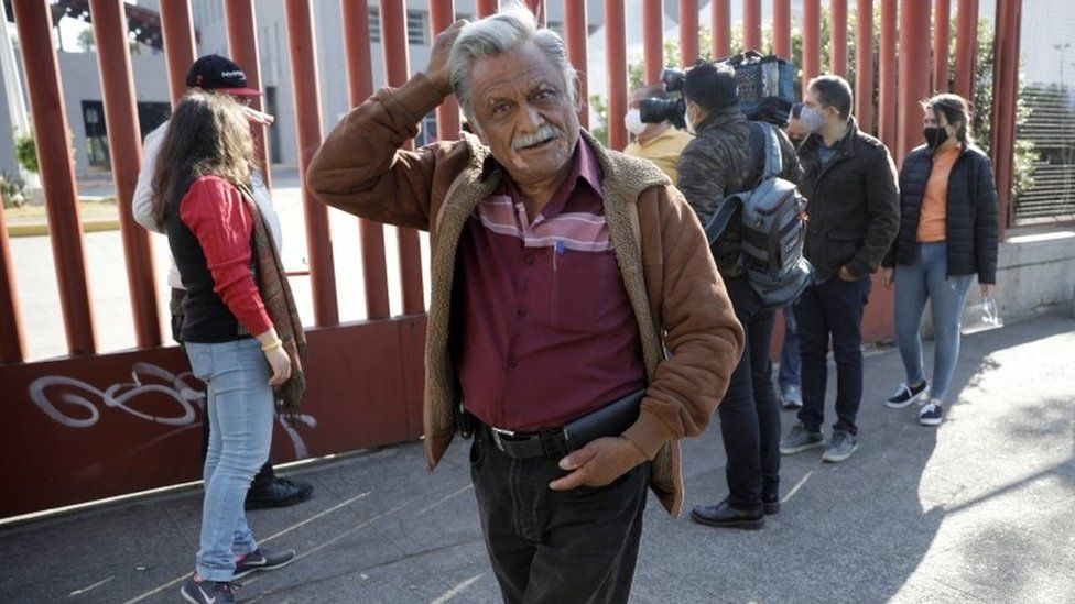 Jorge Hernandez gestures while waiting for news about his 28-year-old nephew Daniel, who had been seriously injured during the accident