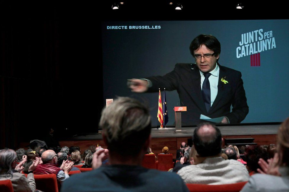 Carles Puigdemont addresses his party in Barcelona in a video conference from Brussels, 12 December