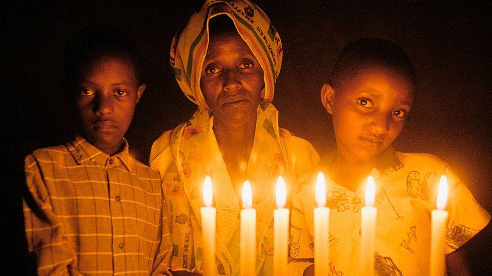 Rwandan genocide rape survivor Marthe Mukandutiye (C) and her children pictured in 2004