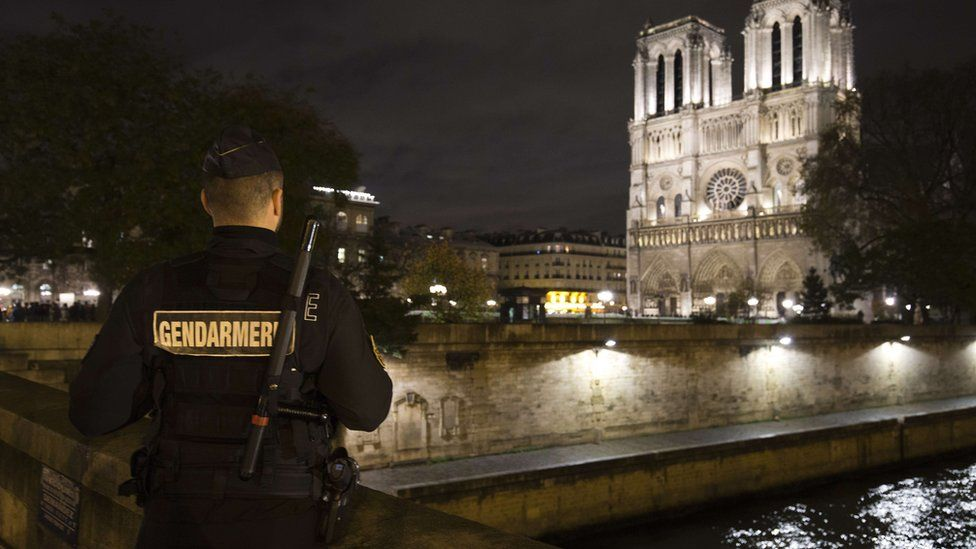 French gendarme near Norte Dame cathedral in Paris on 19 November 2015