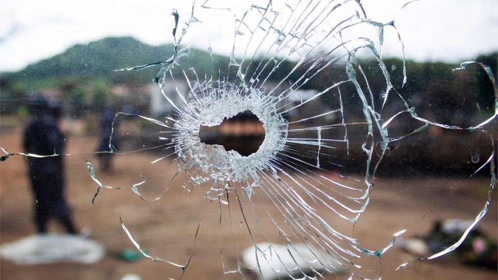 A window with a bullet hole.