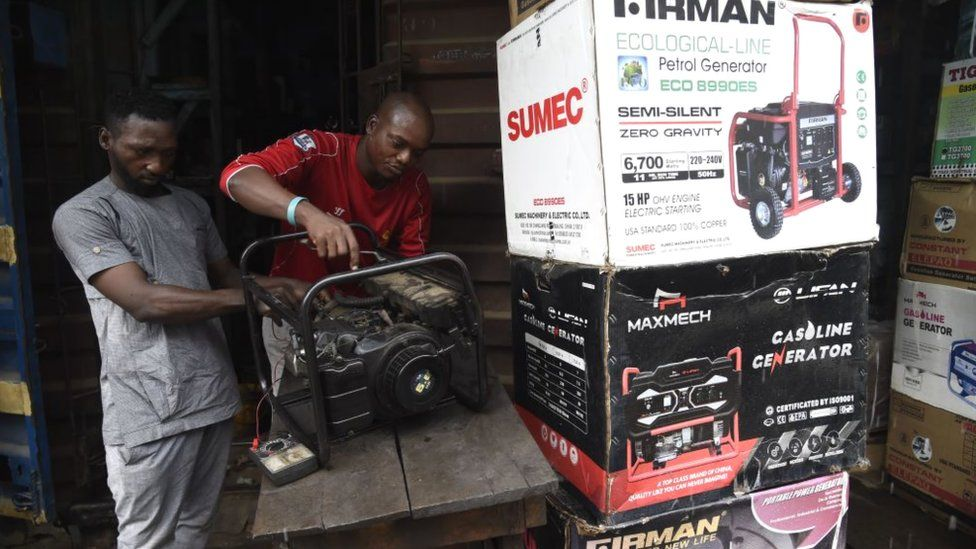 Technicians repair a generator in a shop at Yaba district of Lagos