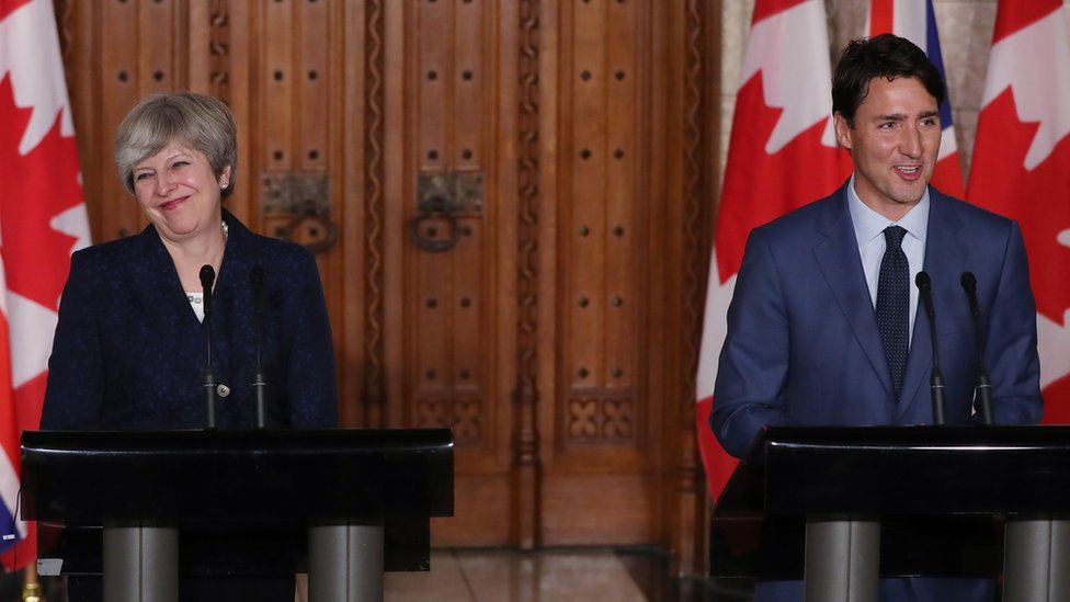 Theresa May and Justin Trudeau at a joint press conference