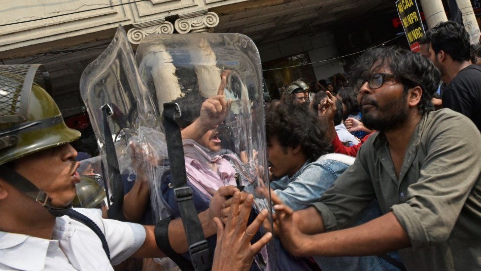 Political party activists, different University students shout slogans and the university students tried to break the police barricades during the protest against India's new citizenship law