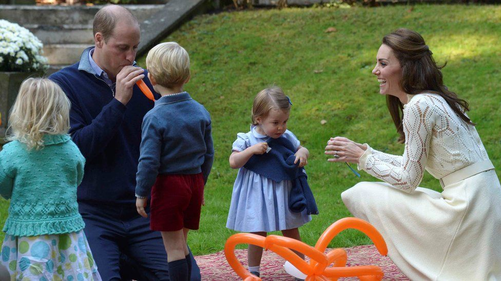 The Cambridges playing with balloons