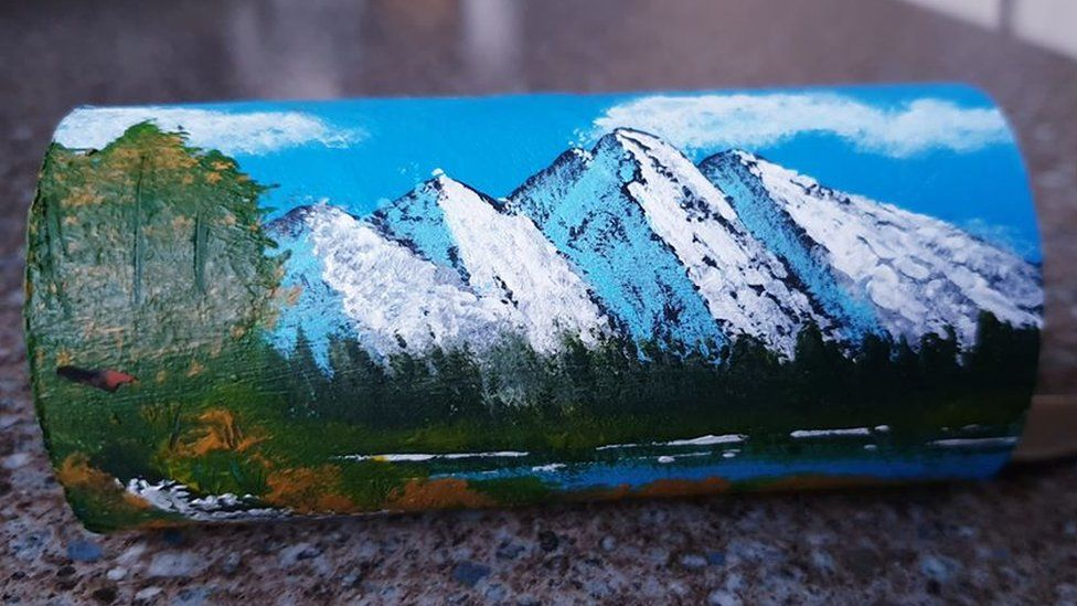 Mountains painted on a toilet roll tube by Maria Alam