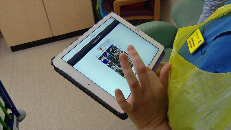 Nurse with a tablet