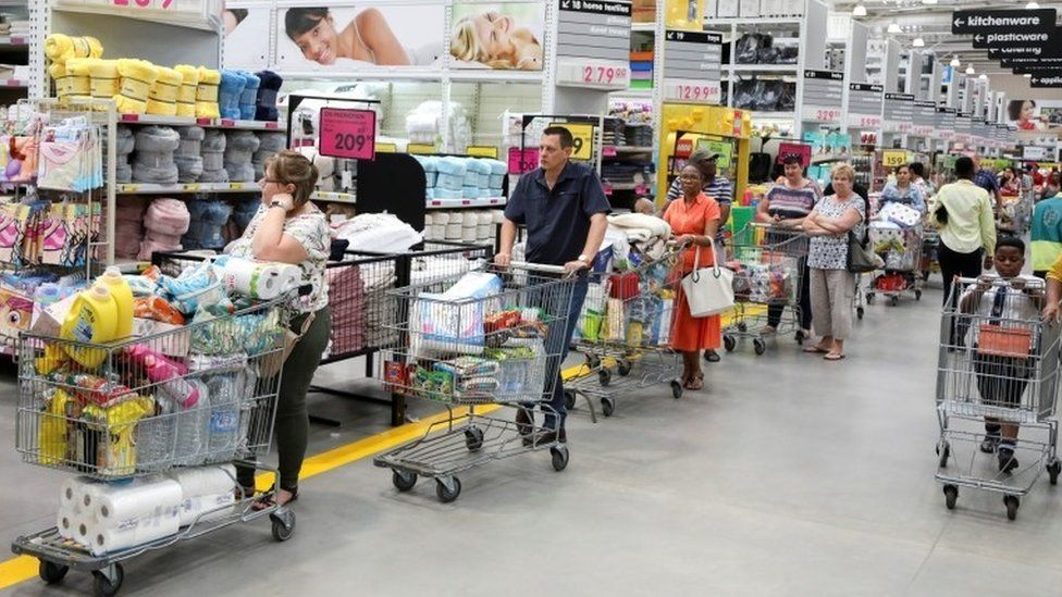 Shoppers stock up on groceries at a Makro store in Johannesburg, South Africa, 16 March 2020