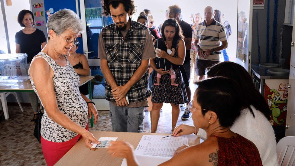 Voters cast their ballots for or against the independence of New Caledonia, November 4, 2018 in Noumea, New Caledonia