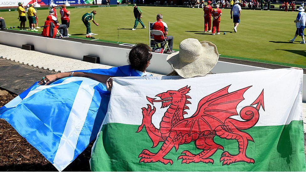 Fans holding a Scottish and Welsh flag attend Kelvingrove Lawn Bowls Centre during day one of the Glasgow 2014 Commonwealth Games