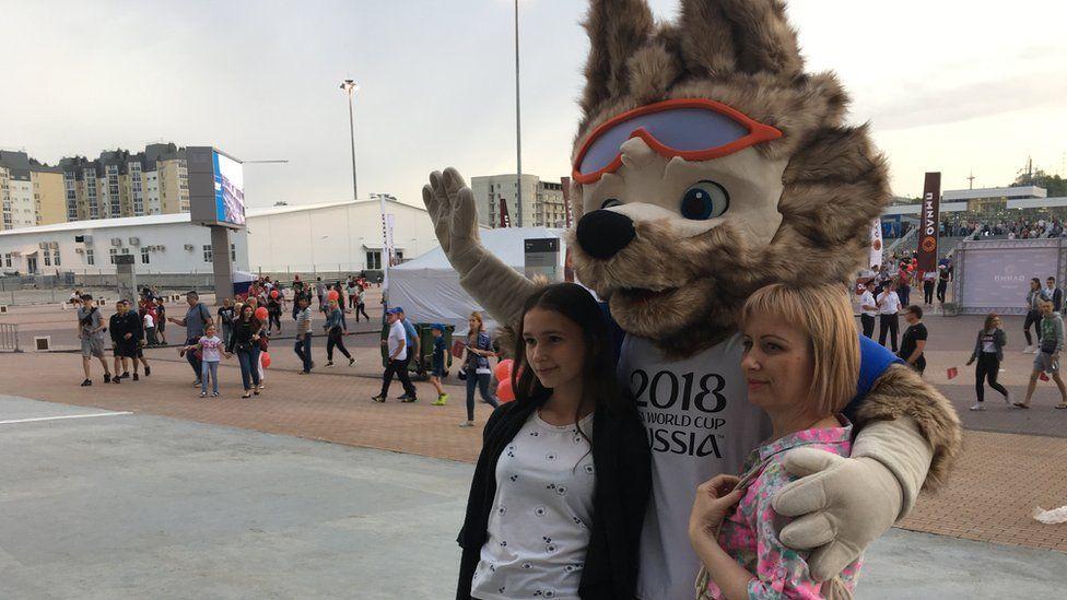 Two locals in Volgograd with World Cup mascot Zabivaka