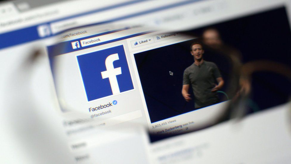 Facebook web page seen through glasses