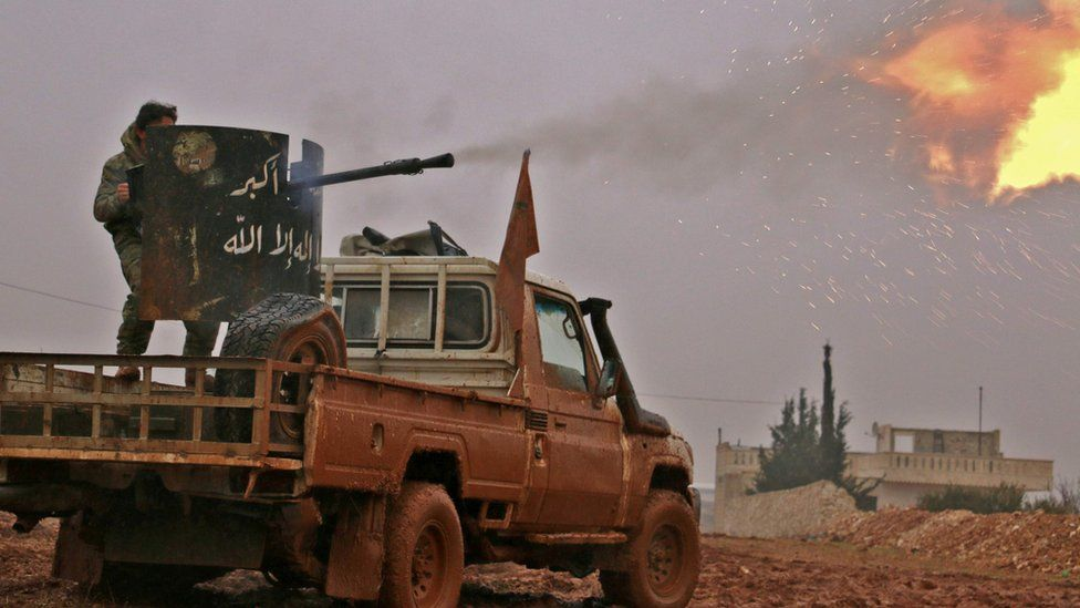 Syrian opposition fighters fire towards positions held by Islamic State (IS) group jihadists in al-Bab